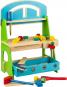 Werkbank mit Werkzeugen. Farbiges Holzspielzeug. Bild 1