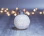 Leuchtende Christbaumkugel, kleine Sterne. Bild 2